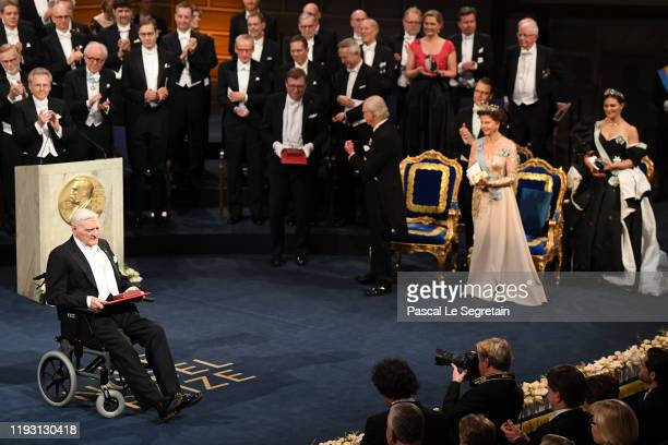 Professor John B Goodenough laureate of the Nobel Prize in Chemistry acknowledges applause after he received his Nobel Prize from King Carl XVI...