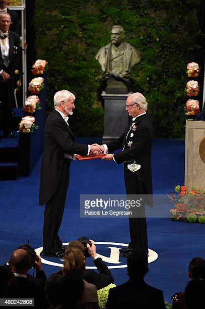 Professor John O'Keefe laureate of the Nobel Prize in Physiology or Medicine receives his Nobel Prize from King Carl XVI Gustaf of Sweden during the...