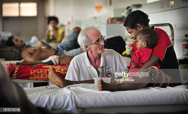 Professor John Vince head of paediatrics at a hospital on August 14 2009 in Port Moresby attends to a young child Since 1996 the number of children...