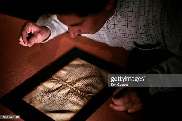 Professor Judson Herrman fellow at the National Humanities Center at Allegheny College examines the Archimedes Palimpsest in Baltimore Maryland...