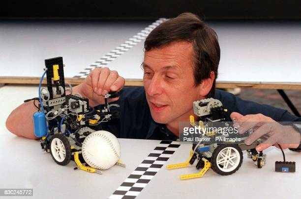 Professor Kevin Warwick from the cybernetics department at Reading University makes the final adustments to robot volleyballers made from Lego smart...