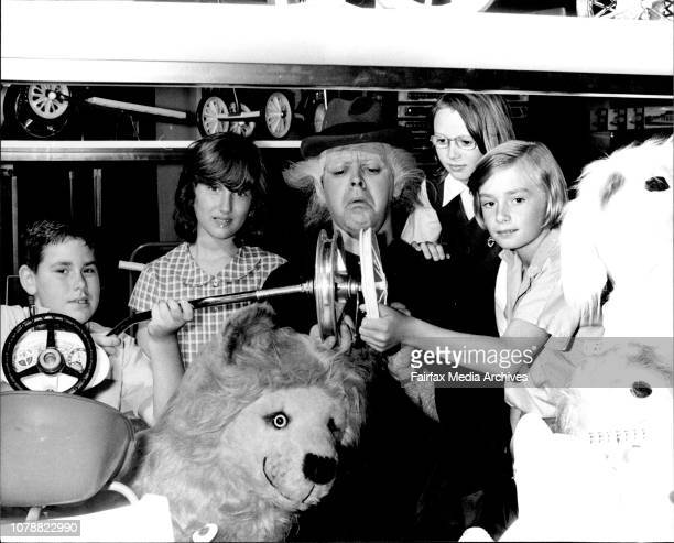 Professor Kobalt with children from the Camperdown Demonstration School looking through the Cyclops Toy Factory L to R Peter Phelps 9 Saphie...