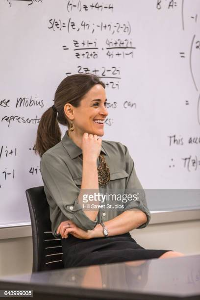 Professor laughing in college classroom