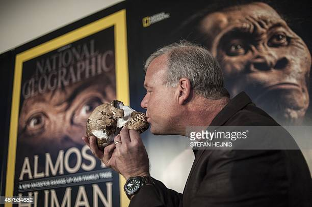 Professor Lee Berger kisses the skull of aHomo Naledi a newly discovered human ancestor during the unveiling of the discovery on September 10 2015 in...