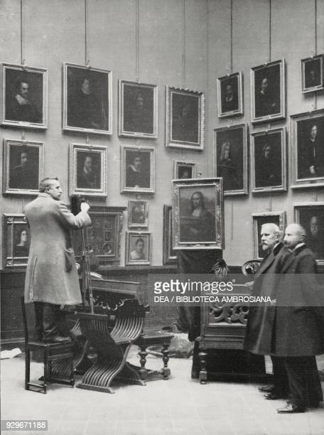Professor Luigi Cavenaghi with The Gioconda exhibited in the Uffizi portrait room after it was recovered in Florence following Vincenzo Peruggia's...