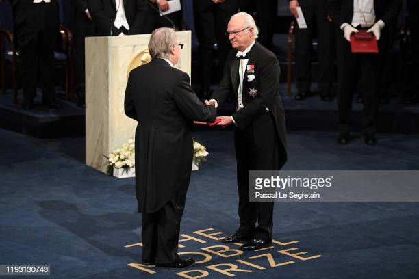 Professor M Stanley Whittingham laureate of the Nobel Prize in Chemistry receives his Nobel Prize from King Carl XVI Gustaf of Sweden during the...