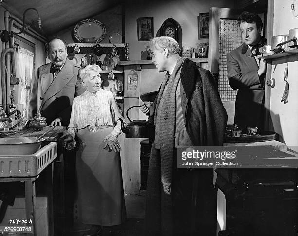 Professor Marcus tries to convince Mrs Wilberforce that he had a good reason for participating in a robbery Major Courtney on the far left and Mr...