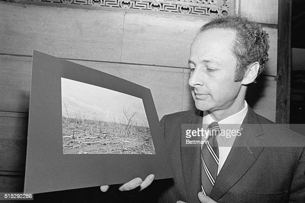 Professor Matthew Meselson of Harvard University and a member of the Herbicide Assessment Commission shows a picture made last August in Vietnam of...