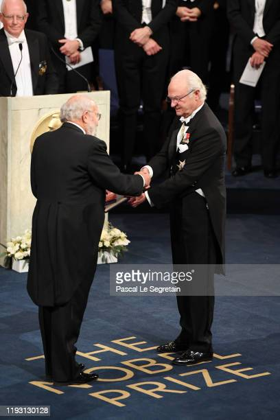 Professor Michel Mayor laureate of the Nobel Prize in Physics receives his Nobel Prize from King Carl XVI Gustaf of Sweden during the Nobel Prize...