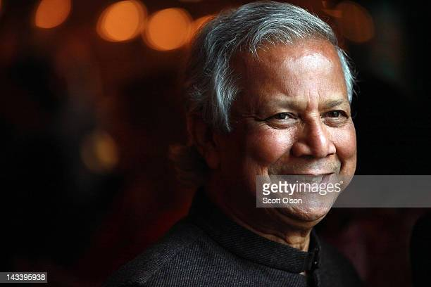 Professor Muhammad Yunus chats with guests at the World Summit of Nobel Peace Laureates at the Chicago Symphony Orchestra Hall on April 25 2012 in...