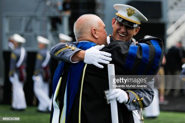 Professor of Engineering John Farr hugs his son, graduating Cadet David Farr during the U.S. Military Academy Class of 2017 graduation ceremony at...