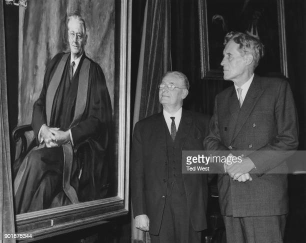 Professor Patrick Blackett the new President of the Royal Society admires a painting of outgoing President Howard Florey at the Royal Society in...