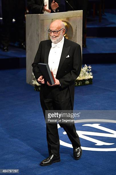 Professor Peter W Higgs laureate of the Nobel Prize in Physics acknowledges applause after he received his Nobel Prize from King Carl XVI Gustaf of...