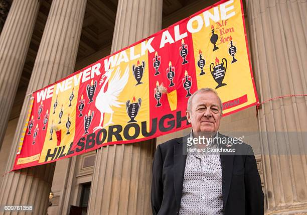 Professor Phil Scraton stands outside St Geroge's Hall as a banner commemorating the Hillsborough disaster hands behind on September 22 2016 in...