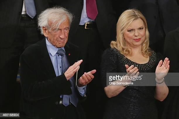Professor political activist and Holocaust survivor Elie Wiesel and Israeli Prime Minister Benjamin Netanyahu's wife Sara Netanyahu applaud for the...
