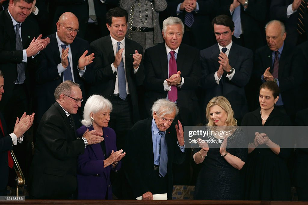 Professor, political activist and Holocaust survivor Elie Wiesel (C) acknowledges applause while attending Israeli Prime Minister Benjamin Netanyahu's address to a joint meeting of the United States Congress with Sara Netanyahu (2nd R) in the House chamber at the U.S. Capitol March 3, 2015 in Washington, DC. At the risk of further straining the relationship between Israel and the Obama Administration, Netanyahu warned members of Congress against what he considers an ill-advised nuclear deal with Iran.