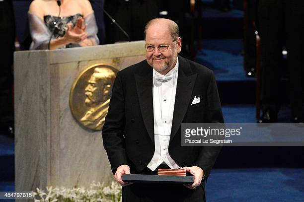 Professor Randy W Schekman laureate of the Nobel Prize in Physiology or Medicine acknowledges applause after he received his Nobel Prize from King...