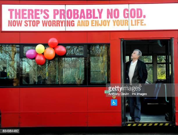 Professor Richard Dawkins on a bus displaying an atheist message in Kensington Gardens London