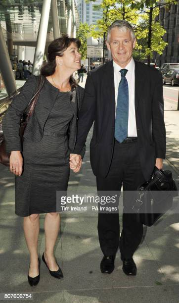 Professor Simon Murch leaves the GMC in London with his wife Alison after he was found not guilty of serious professional misconduct