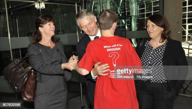 Professor Simon Murch with his wife Alison is hugged by supporter 17yearold autism sufferer Josh Edwards outside the GMC in London after he was found...