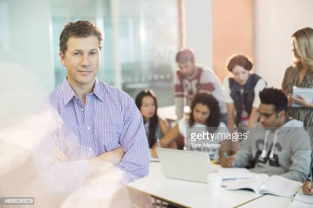 Professor standing in classroom