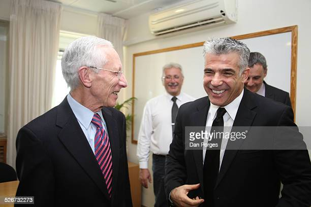 Professor Stanley Fischer, Governor of the Bank of Israel talking and laughing with Finance Minister Yair Lapid in the Finance Ministry, Jerusalem,...