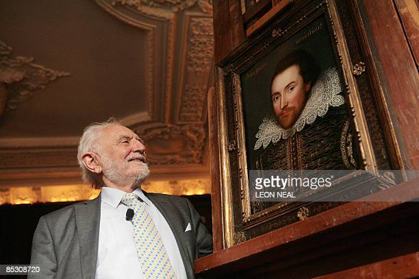 Professor Stanley Wells CBE admires a portrait of William Shakespeare in London on March 9 2009 The portrait painted in 1610 is believed to be the...