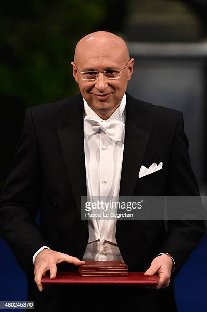 Professor Stefan W Hell laureate of the Nobel Prize in Chemistry acknowledges applause after he received his Nobel Prize from King Carl XVI Gustaf of...