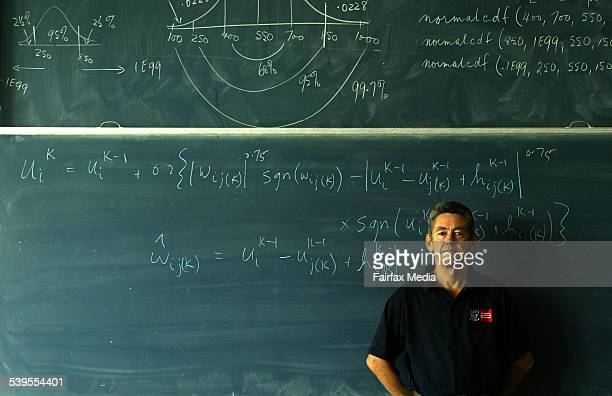 Professor Stephen Clarke is pictured with a formula he has written to win footy tipping comps Picture taken at Swinburne Uni in Melbourne 15 April...