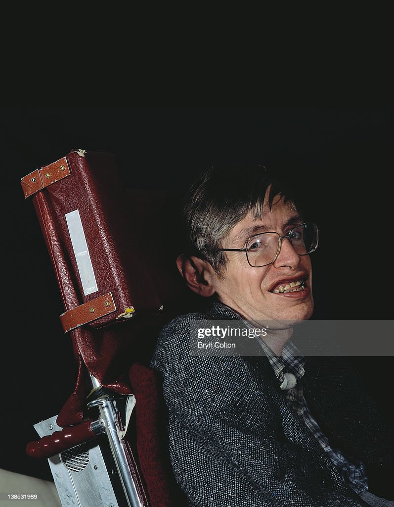 Professor Stephen Hawking poses for a photograph in his office at the University of Cambridge in Cambridge, U.K, in April 1991. Hawking has written countless scientific papers as well as books, receiving 12 honorary degrees and becoming Cambridge's Lucasian Professor of Mathematics, a post held by Sir Isaac Newton over 300 years earlier.