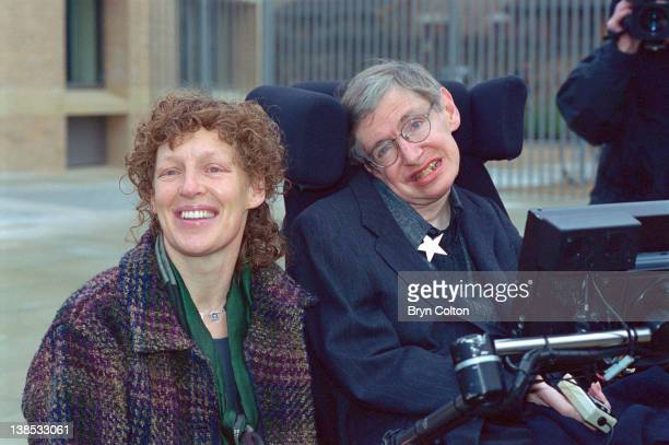 Professor Stephen Hawking right and his second wife Elaine Hawking pose for a photograph while attending a symposium to mark his 60th birthday at the...