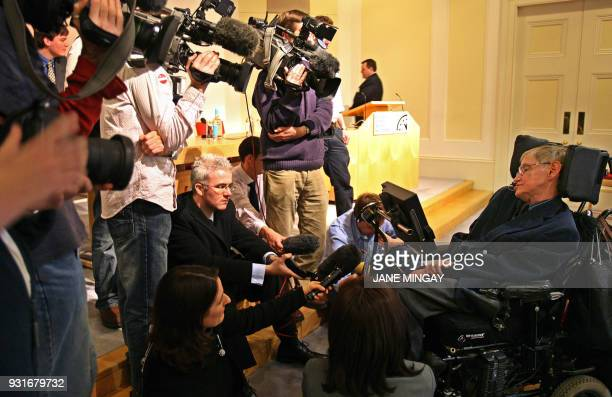 Professor Stephen W Hawking is surrounded by media before he addressed a joint press conference between Washington and London where the directors of...