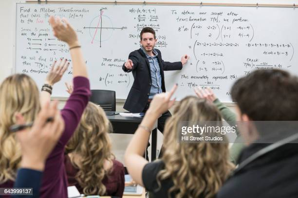 Professor taking questions in college classroom