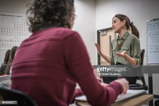 professor talking to students in college classroom - caldwell idaho stock pictures, royalty-free photos & images