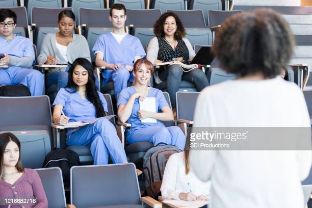 professor teaches a class of medical students - medical student stock pictures, royalty-free photos & images