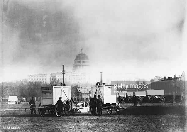 Professor Thaddeus Lowe sets up balloon gas generators in sight of the US Capitol Washington DC ca 1861