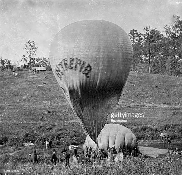Professor Thaddeus S Lowe inflating the balloon Intrepid with air taken from the balloon Constitution in order to provide a vantage point for the...