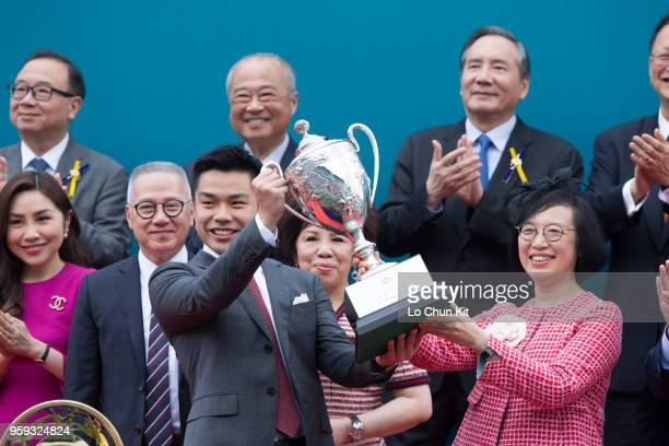 KONG APRIL Professor the Hon Sophia Chan Siuchee Secretary for Food and Health of the Government of the HKSAR presents the Champions Mile trophy to...
