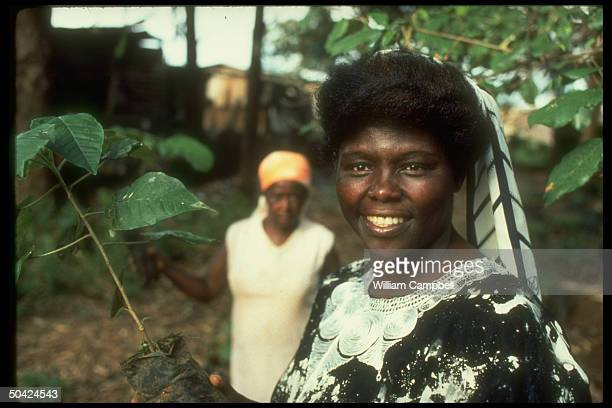 Professor Wangari Maathai standing outside re her org of the Green Belt Movement which plants trees to stem advance of Sahara desert