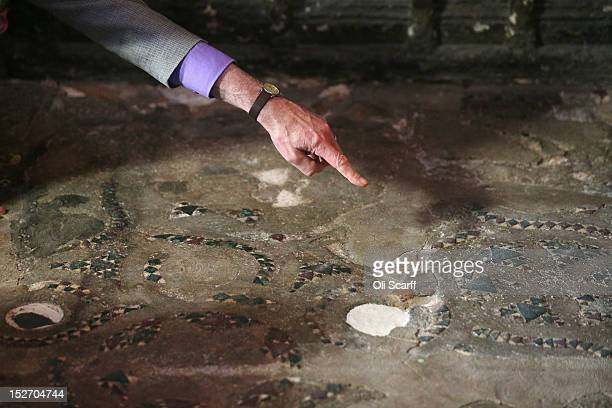 Professor Warwick Rodwell, Westminster Abbey's Archaeologist, examines the Cosmati pavement surrounding the tomb of Edward the Confessor to asses it...
