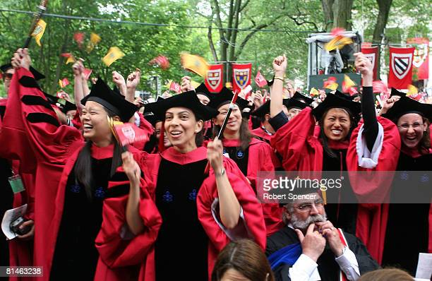 A professor whistles while graduating Ph D students celebrate at Harvard University's commencement ceremonies June 5 in Cambridge Massachusetts JK...