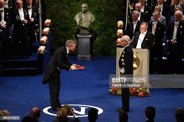 Professor William E Moerner laureate of the Nobel Prize in Chemistry receives his Nobel Prize from King Carl XVI Gustaf of Sweden during the Nobel...