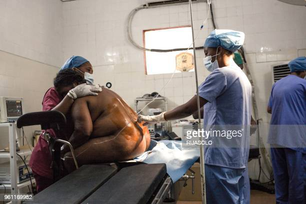 Professor Yoel Rantomalala and his team perform a repair surgery on a fistula patient in the operating room of Monja Joana Hospital in Ambovombe on...