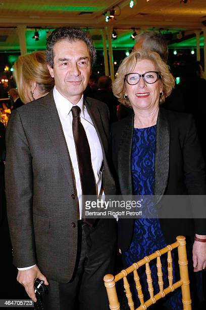 Professor Yves Levy and French Minister of Higher Education and Research Genevieve Fioraso attend the Sidaction Gala Dinner 2014 at Pavillon...