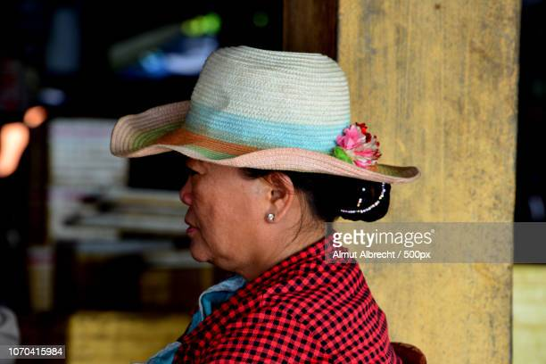 profil of a woman with hat - profil stock photos and pictures