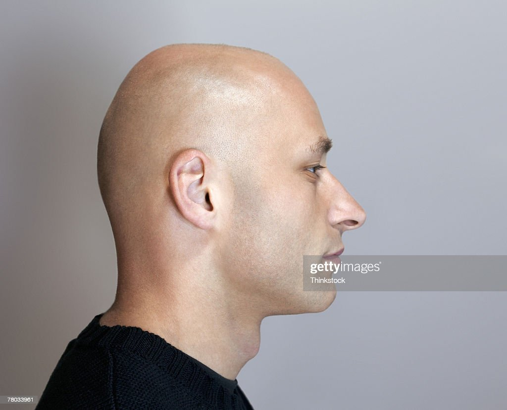 Profile headshot of a bald man with his eyes closed : Stock Photo