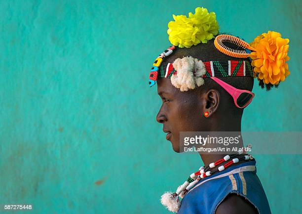 Profile of a bana tribe man with plastic flowers in the hair omo valley key afer Ethiopia on March 17 2016 in Key Afer Ethiopia