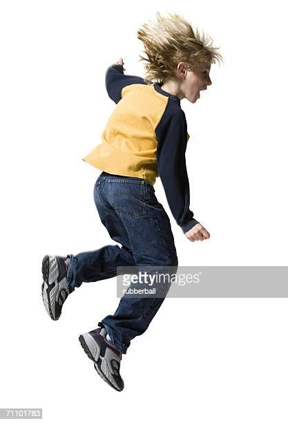 Profile of a boy jumping