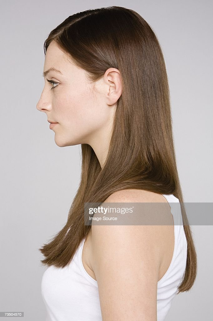 Profile of a brunette woman : Stock Photo