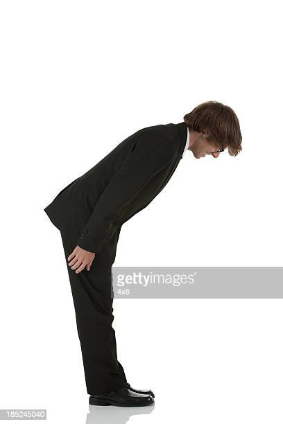 Profile of a businessman bowing